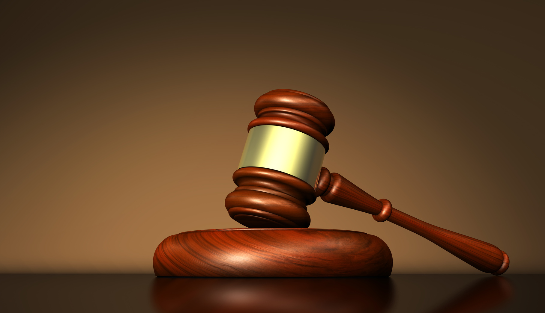 Law justice and judge symbol concept with a gavel on a wooden desktop 3D illustration.