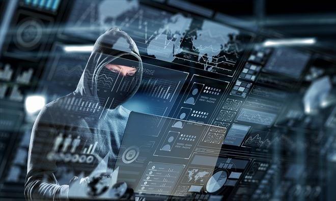 Hacker man in hoodie with laptop in hands. Mixed media