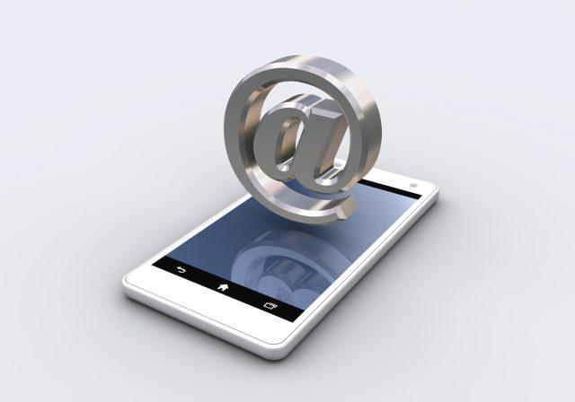 email symbol and smartphone